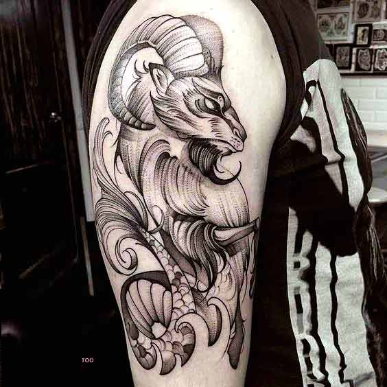 Upper bicep capricorn tattoo design for men