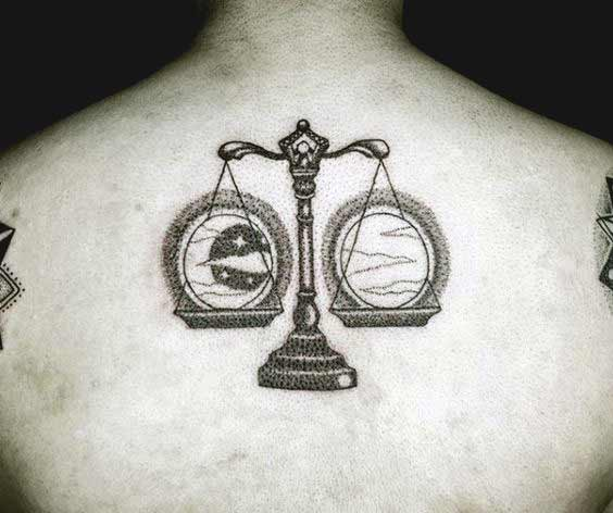 Libra tattoo design with moon and sun on back