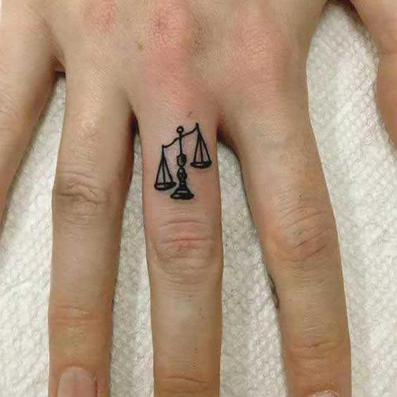 best libra tattoos on finger for girls