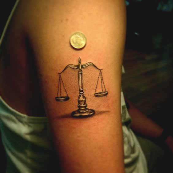 Realistic Libra tattoo design on arm ideas for girls
