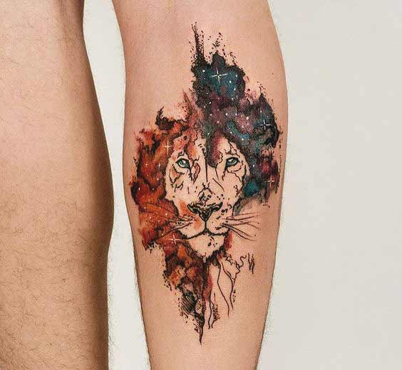 Lion face with constellation tattoo on leg