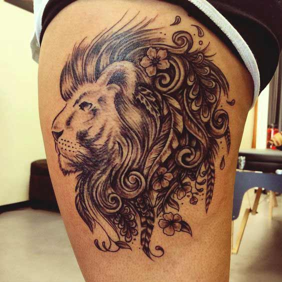 Leo face tattoo designs on thigh