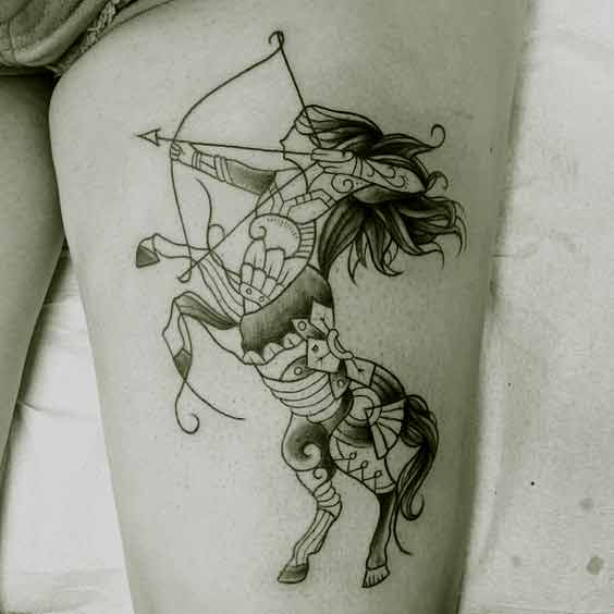 Amazing Sagittarius zodiac tattoo design on thigh